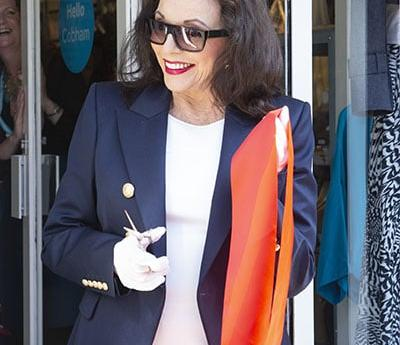 Vice President Dame Joan Collins officially opens shop